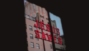 """Jesus Saves"" street sign."