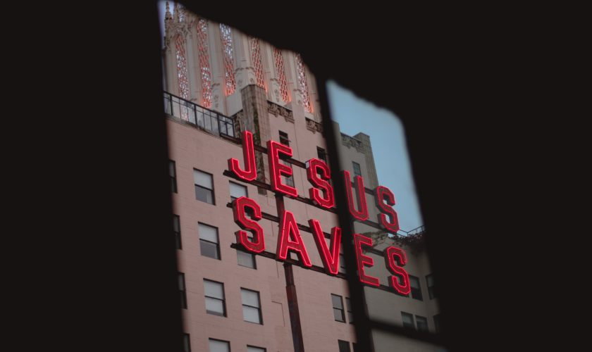 """Jesus Saves"" street sign."